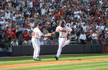 ATLANTA - APRIL 5: Jason Heyward #22 of the Atlanta Braves is congratulated by Coach Brian Snitker #51 after hitting a 3 run home run against the Chicago Cubs during Opening Day at Turner Field on April 5, 2010 in Atlanta, Georgia. (Photo by Scott Cunning