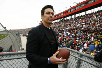 FONTANA, CA - FEBRUARY 22:  Jason Sehorn, former New York Giants football player, looks to throw an autographed football to the crowd prior to the start of the NASCAR Sprint Cup Series Auto Club 500 at Auto Club Speedway on February 22, 2009 in Fontana, C