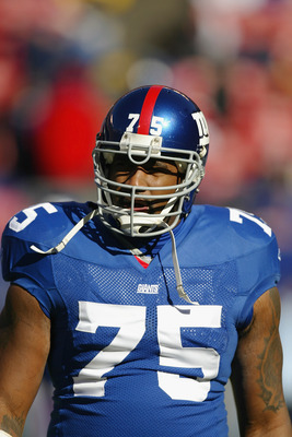 EAST RUTHERFORD, NJ - NOVEMBER 9:  Defensive tackle Keith Hamilton #75 of the New York Giants stands on the field during the game against the Atlanta Falcons at Giant Stadium on November 9, 2003 in East Rutherford, New Jersey. The Falcons defeated the Gia