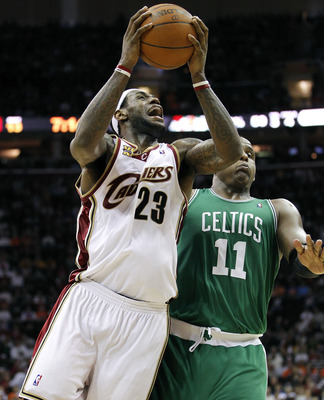CLEVELAND - MAY 11:  LeBron James #23 of the Cleveland Cavaliers tries to get a shot off around Glen Davis #11 of the Boston Celtics during Game Five of the Eastern Conference Semifinals during the 2010 NBA Playoffs at Quicken Loans Arena on May 11, 2010
