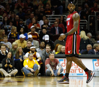 CLEVELAND - MARCH 29: LeBron James #6 of the Miami Heat walks back to the bench during the game against the Cleveland Cavaliers on March 29, 2011 at Quicken Loans Arena in Cleveland, Ohio. NOTE TO USER: User expressly acknowledges and agrees that, by down