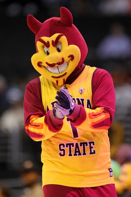 LOS ANGELES, CA - MARCH 09:  Sparky, the mascot for the Arizona State Sun Devils, performs on the court during a break in the game between the Sun Devils and the Oregon Ducks in the first round of the 2011 Pacific Life Pac-10 Men's Basketball Tournament a