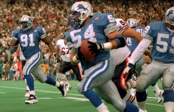 10 NOV 1991:  Chris Spielman, #54, linebacker for the Detroit Lions, tries to evade the block of Tampa Bay Buccaneer tight end Jesse Anderson, #89, during Tampa Bay's 30-21 victory at Tampa Stadium, Tampa Bay, Florida.  MANDATORY CREDIT:  RICK STEWART/