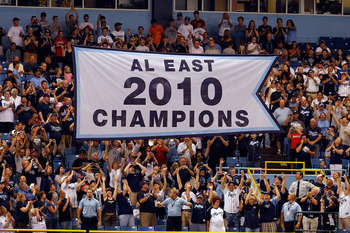 ST. PETERSBURG, FL - APRIL 01:  The Tampa Bay Rays raise their 2010 American League East championship banner just before the start of the Opening Day game against the Baltimore Orioles at Tropicana Field on April 1, 2011 in St. Petersburg, Florida.  (Phot