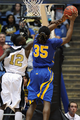 DAYTON, OH - MARCH 17: Ivory White #12 of the Alabama State Hornets fouls Kenneth Faried #35 of the Morehead State Eagles during the opening round of the Men's NCAA Tournament on March 17, 2009 at the University of Dayton Arena in Dayton, Ohio.  (Photo by
