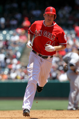 ANAHEIM, CA - JUNE 5:  Mark Trumbo #44 of the Los Angeles Angels of Anaheim circles the bases after hitting a ome run in the third inning against the New York Yankees on June 5, 2011 at Angel Stadium in Anaheim, California. The Yankees won 5-3.  (Photo by