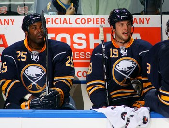BUFFALO, NY - OCTOBER 3:  Mike Grier #25 and Tim Connolly #19 of the Buffalo Sabres looks on from the bench area during a break in NHL game action against the Montreal Canadiens at HSBC Arena on October 3, 2009 in Buffalo, New York. The Canadiens defeated