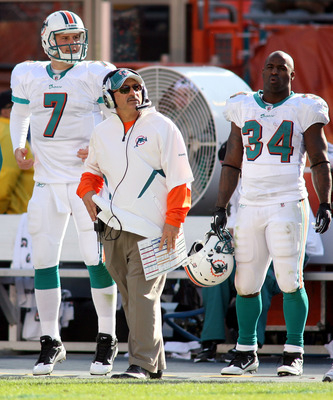 MIAMI - DECEMBER 26: (L-R) Quarterback Chad Henne #7, coach Tony Sparano and running back Ricky Williams #34 of the Miami Dolphins look on from the sidelines against the Detroit Lions at Sun Life Stadium on December 26, 2010 in Miami, Florida.  (Photo by