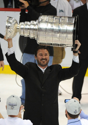 DETROIT - JUNE 12:  Mario Lemieux of the Pittsburgh Penguins celebrates with the Stanley Cup after defeating the Detroit Red Wings by a score of 2-1 to win Game Seven and the 2009 NHL Stanley Cup Finals at Joe Louis Arena on June 12, 2009 in Detroit, Mich