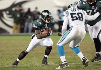 PHILADELPHIA - DECEMBER 4:  Correll Buckhalter #28 of the Philadelphia Eagles carries the ball against Thomas Davis #58 of the Carolina Panthers at Lincoln Financial Field on December 4, 2006 in Philadelphia, Pennsylvania. (Photo by Jim McIsaac/Getty Imag