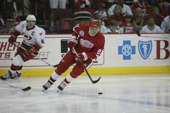 RALEIGH, NC - JUNE 8:  Center Sergei Fedorov #91 of the Detroit Red Wings looks to play the puck at the blueline against the Carolina Hurricanes during game three of the NHL Stanley Cup Finals at the Entertainment and Sports Arena in Raleigh, North Caroli