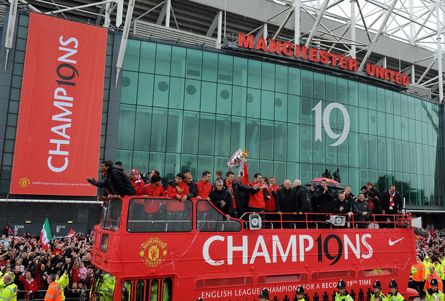 MANCHESTER, ENGLAND - MAY 30:  The Manchester United open top bus travels past Old Trafford during the Manchester United Premier League Winners Parade at Old Trafford on May 30, 2011 in Manchester, United Kingdom.  (Photo by Chris Brunskill/Getty Images)