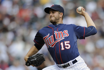 MINNEAPOLIS, MN - APRIL 13: Glen Perkins #15 of the Minnesota Twins pitches against the Kansas City Royals during the seventh inning of their game on April 13, 2011 at Target Field in Minneapolis, Minnesota. Royals defeated the Twins 10-5. (Photo by Hanna