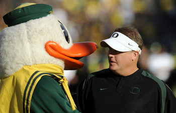EUGENE, OR - OCTOBER 2: Head coach Chip Kelly of the Oregon Ducks is greeted by 'Puddles', the mascot of the Oregon Ducks, before the game against the Stanford Cardinal at Autzen Stadium on October 2, 2010 in Eugene, Oregon. Oregon won the game 52-31. (Ph