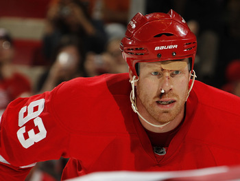 DETROIT, MI - APRIL 16: Johan Franzen #93 of the Detroit Red Wings skates against the Phoenix Coyotes in Game Two of the Western Conference Quarterfinals during the 2011 Stanley Cup Playoffs at Joe Louis Arena on April 16, 2011 in Detroit, Michigan.  (Pho