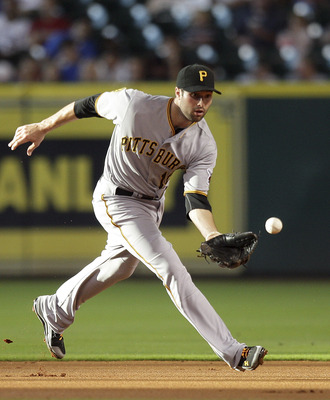 HOUSTON - JUNE 15:  Second baseman Neil Walker #18 of the Pittsburgh Pirates makes a play on a ground ball against the Houston Astros at Minute Maid Park on June 15, 2011 in Houston, Texas.  (Photo by Bob Levey/Getty Images)
