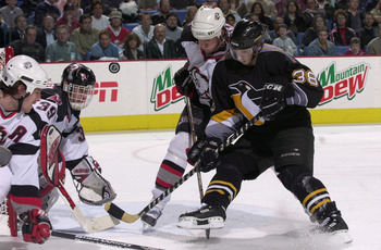 26 Apr 2001:  Jan Hrdina #38 of the Pittsburgh Penguins takes a shot on goalie Dominik Hasek #39 of the Buffalo Sabres during Game on1e of the Eastern Conference semifinals in the Stanley Cup playoffs at the HSBC Arena in Buffalo, New York. The Penguins w
