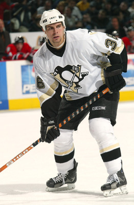 BUFFALO, NY - NOVEMBER 14:  Right wing Tom Kostopoulos #26 of the Pittsburgh Penguins stands on the ice during the game against the Buffalo Sabres at HSBC Arena on November 14, 2003 in Buffalo, New York.  The Penguins won 2-1, in overtime.  (Photo by Rick
