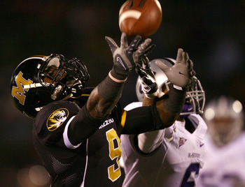 COLUMBIA, MO - NOVEMBER 08:  Jeremy Maclin #9 of the Missouri Tigers reaches for a pass as Blair Irvin #6 of the Kansas State Wildcats defends during the game on November 8, 2008 at Memorial Stadium in Columbia, Missouri.  (Photo by Jamie Squire/Getty Ima