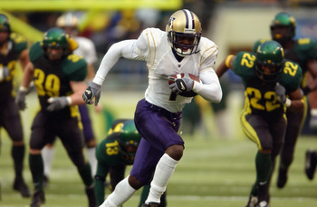 EUGENE - NOVEMBER 16:  Wide Receiver Reggie Williams #1 of the Washington Huskies scores a touchdown on this run in the fourth quarter against the Oregon Ducks during their game on November 16, 2002 at Autzen Stadium in Eugene Oregon. (Photo by Otto Greul