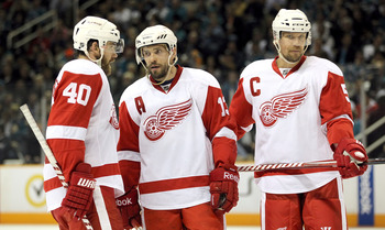 SAN JOSE, CA - MAY 12:  Henrik Zetterberg #40, Pavel Datsyuk #13, and Nicklas Lidstrom #5 of the Detroit Red Wings talk to each other before a face off against the San Jose Sharks in Game Seven of the Western Conference Semifinals during the 2011 NHL Stan