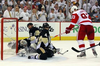 PITTSBURGH - JUNE 09:  Johan Franzen #93 of the Detroit Red Wings has his shot blocked by Rob Scuderi #4 of the Pittsburgh Penguins late in Game Six of the NHL Stanley Cup Finals at the Mellon Arena on June 9, 2009 in Pittsburgh, Pennsylvania.  (Photo by