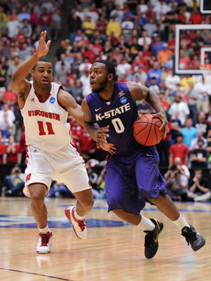 TUCSON, AZ - MARCH 19:  Jacob Pullen #0 of the Kansas State Wildcats drives against Jordan Taylor #11 of the Wisconsin Badgers during the third round of the 2011 NCAA men's basketball tournament at McKale Center on March 19, 2011 in Tucson, Arizona.  (Pho