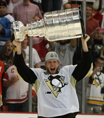 DETROIT - JUNE 12: Jordan Staal #11 of the Pittsburgh Penguins celebrates with the Stanley Cup following the Penguins victory over the Detroit Red Wings in Game Seven of the 2009 NHL Stanley Cup Finals at Joe Louis Arena on June 12, 2009 in Detroit, Michi