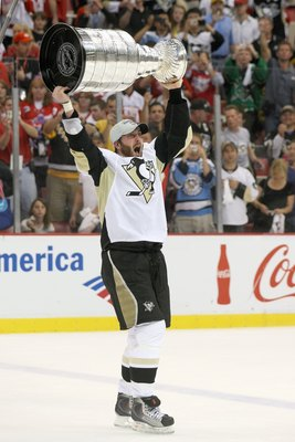 DETROIT - JUNE 12: Brooks Orpik #44 of the Pittsburgh Penguins celebrates with the Stanley Cup after defeating the Detroit Red Wings by a score of 2-1 to win Game Seven and the 2009 NHL Stanley Cup Finals at Joe Louis Arena on June 12, 2009 in Detroit, Mi
