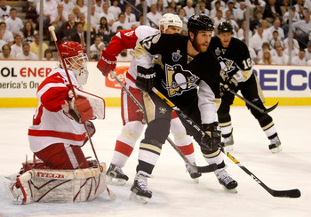 PITTSBURGH - MAY 31:  Ryan Malone #12 of the Pittsburgh Penguins sets up in front of goaltender Chris Osgood #30 and Nicklas Lidstrom #5 of the Detroit Red Wings  during game four of the 2008 NHL Stanley Cup Finals at Mellon Arena on May 31, 2008 in Pitts