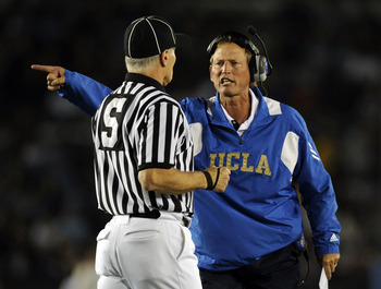 PASADENA, CA - SEPTEMBER 11:  Head Coach Rick Neuheisel of UCLA yells at the referee during the second quarter against Stanford at the Rose Bowl on September 11, 2010 in Pasadena, California.  (Photo by Harry How/Getty Images)
