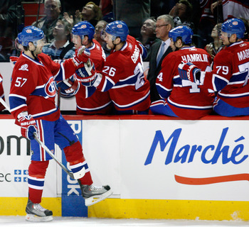 MONTREAL- JANUARY 16:  Benoit Pouliot #57 of the Montreal Canadiens celebrates his first period goal with the team mates during the NHL game against the Ottawa Senators on January 16, 2010 at the Bell Centre in Montreal, Quebec, Canada.  (Photo by Richard