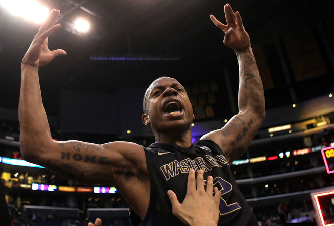 LOS ANGELES, CA - MARCH 12:  Isaiah Thomas #2 of the Washington Huskies reacts after making a last-second shot in overtime to defeat the Arizona Wildcats 77-75 in the championship game of the 2011 Pacific Life Pac-10 Men's Basketball Tournament at Staples