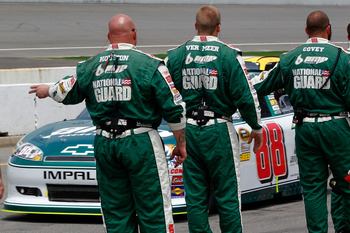 BROOKLYN, MI - JUNE 19:  Dale Earnhardt Jr., driver of the #88 Amp Energy/National Guard Chevrolet, drives past crew members on pit road prior to the NASCAR Sprint Cup Series Heluva Good! Sour Cream Dips 400 at Michigan International Speedway on June 19,