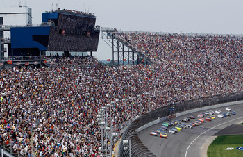 BROOKLYN, MI - JUNE 19:  A view of the field passing the grand stands during the NASCAR Sprint Cup Series Heluva Good! Sour Cream Dips 400 at Michigan International Speedway on June 19, 2011 in Brooklyn, Michigan.  (Photo by Gregory Shamus/Getty Images fo