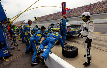 BROOKLYN, MI - JUNE 19:  A.J. Allmendinger, driver of the #43 Best Buy Ford, makes a pit stop during the NASCAR Sprint Cup Series Heluva Good! Sour Cream Dips 400 at Michigan International Speedway on June 19, 2011 in Brooklyn, Michigan.  (Photo by Tom Pe