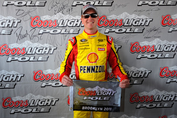 BROOKLYN, MI - JUNE 18:  Kurt Busch, driver of the #22 Shell/Pennzoil Dodge, celebrates setting the pole position following qualifying for the NASCAR Sprint Cup Series Heluva Good! Sour Cream Dips 400 at Michigan International Speedway on June 18, 2011 in