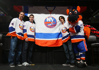 UNIONDALE, NY - JUNE 25:  (L-R) Trevor Gillies, John Tavares, Matt Moulson and Sparky the Dragon pose for a photo wearing their 2010-2011 road jersey's during the New York Islanders Draft Day Party on June 25, 2010 at Nassau Coliseum in Uniondale, New Yor