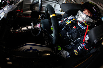 BROOKLYN, MI - JUNE 17:  Jimmie Johnson, driver of the #48 Lowe's/Kobalt Tools Chevrolet, sits in his car during practice for the NASCAR Sprint Cup Series Heluva Good! Sour Cream Dips 400 at Michigan International Speedway on June 17, 2011 in Brooklyn, Mi