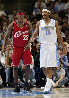 DENVER - DECEMBER 2:  Carmelo Anthony #15 of the Denver Nuggets and LeBron James #23 of the Clevelenad Cavaliers cover each other during the fourth quarter December 2, 2003 at the Pepsi Center in Denver, Colorado.  Anthony had 26 points; James 19, in the
