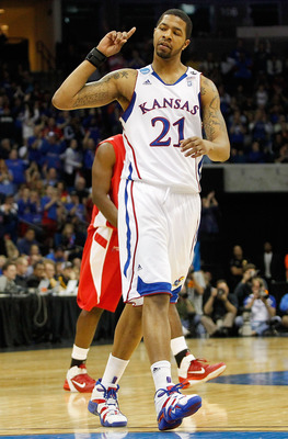 TULSA, OK - MARCH 18:  Markieff Morris #21 of the Kansas Jayhawks reacts to a play against the Boston University Terriers during the second round of the 2011 NCAA men's basketball tournament at BOK Center on March 18, 2011 in Tulsa, Oklahoma.  (Photo by T