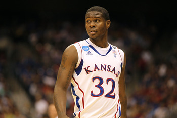 SAN ANTONIO, TX - MARCH 25:  Josh Selby #32 of the Kansas Jayhawks looks on during the southwest regional of the 2011 NCAA men's basketball tournament against the Richmond Spiders at the Alamodome on March 25, 2011 in San Antonio, Texas. Kansas defeated R