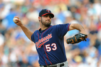 KANSAS CITY, MO - JUNE 4:  Starting pitcher Nick Blackburn #53 of the Minnesota Twins throws a pitch against the Kansas City Royals at Kauffman Stadium on June 4, 2011 in Kansas City, Missouri. (Photo by G. Newman Lowrance/Getty Images)