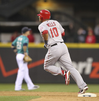 SEATTLE - JUNE 13:  Vernon Wells #10 of the Los Angeles Angels of Anaheim rounds second base after hitting a two-run homer in the seventh inning against the Seattle Mariners at Safeco Field on June 13, 2011 in Seattle, Washington. (Photo by Otto Greule Jr