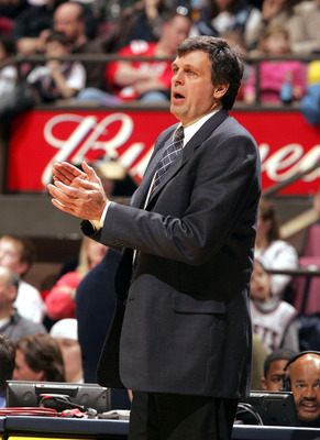 EAST RUTHERFORD , NJ - MARCH 26:  Head coach Kevin McHale of the Minnesota Timberwolves applaudes his teams effort during their game against the New Jersey Nets on March 26, 2005 at Continental Airlines Arena in East Rutherford, New Jersey.  NOTE TO USER: