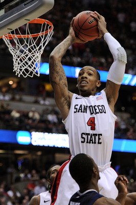 ANAHEIM, CA - MARCH 24:  Malcolm Thomas #4 of the San Diego State Aztecs goes up for the ball against the Connecticut Huskies during the west regional semifinal of the 2011 NCAA men's basketball tournament at the Honda Center on March 24, 2011 in Anaheim,