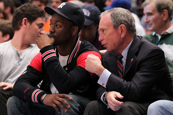 NEW YORK, NY - APRIL 24:  NBA draft prospect Kemba Walker (L) from the University of Connecticut Huskies and New York City Mayor Michael Bloomberg watch the New York Knicks play against the Boston Celtics in Game Four of the Eastern Conference Quarterfina