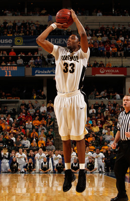 INDIANAPOLIS - MARCH 12:  Guard E'Twaun Moore #33 of the Purdue Boilermakers takes a shot against the Northwestern Wildcats during the quarterfinals of the Big Ten Men's Basketball Tournament at Conseco Fieldhouse on March 12, 2010 in Indianapolis, Indian