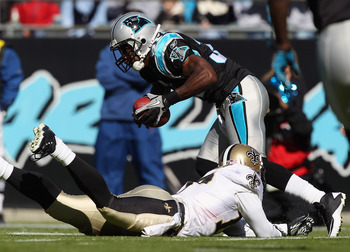 CHARLOTTE, NC - NOVEMBER 07:  Robert Meachem #17 of the New Orleans Saints tries to tackle Richard Marshall #31 of the Carolina Panthers after an interception during their game at Bank of America Stadium on November 7, 2010 in Charlotte, North Carolina.