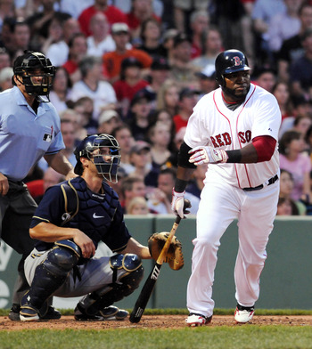 BOSTON, MA - JUNE 18:  David Ortiz #34 of the Boston Red Sox hits a single in the third inning against the Milwaukee Brewers at Fenway Park on June 18, 2011 in Boston, Massachusetts. (Photo by Darren McCollester/Getty Images)